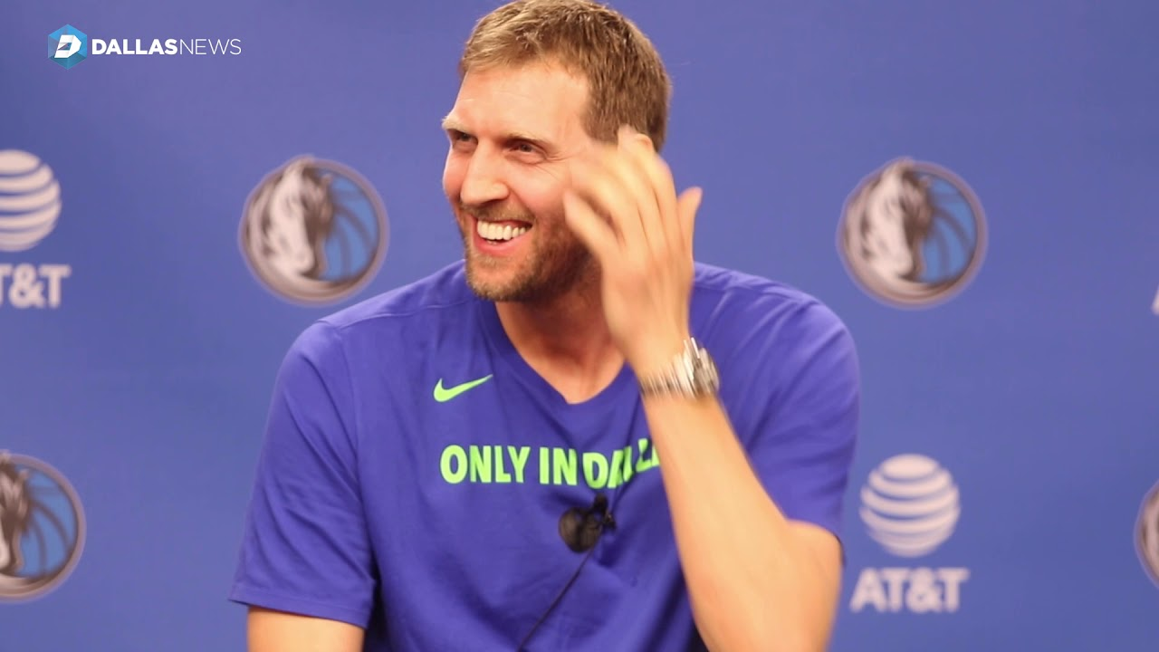 tyson-chandler-takes-photos-of-dirk-nowitzki-during-his-end-of-year-press-conference
