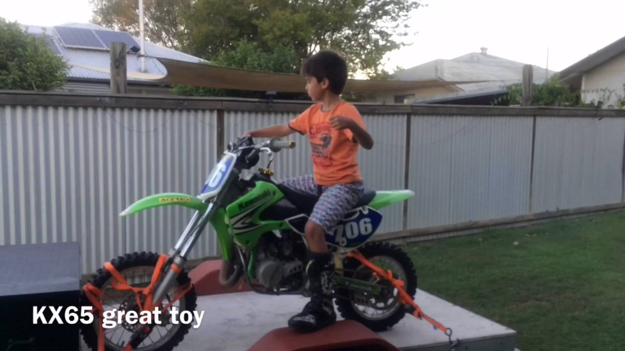 Our 9 yr old boys first 2 stroke KX65