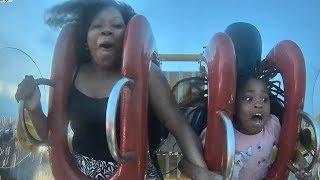girl falls of roller coaster lands on..