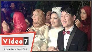 شاب صينى يشهر إسلامه ليتزوج بفتاة مسلمة فى دمياط