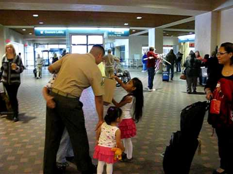 Marine Arriving at Albuquerque Airport with greeters and family to welcome him
