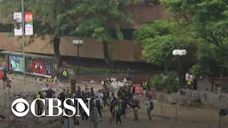 Protesters and police locked in tense standoff at Hong Kong university