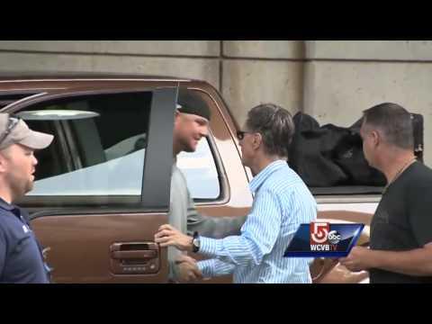Red Sox owner John Henry hugs Jon Lester