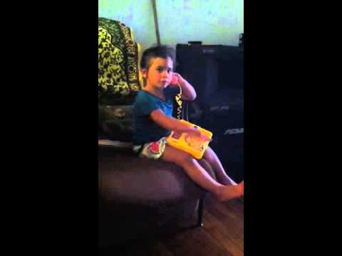 Dominican kid talking on the phone
