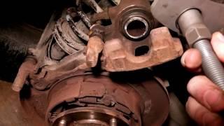 Mitsubishi Lancer 9 задние суппорта подклинивание ремонт