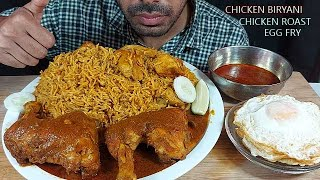 massive masala chicken BIRYANI with spicy chicken roast and Egg fry with extra spicy gravy eating