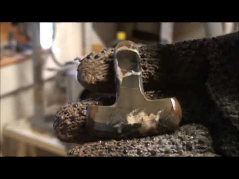 Carving and grinding a septarian stone into a mjolnir amulet jewelry