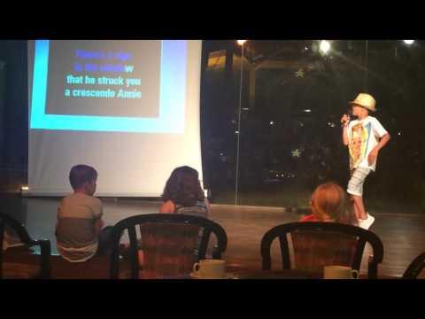 Kid does amazing karaoke dance to Michael Jackson smooth criminal