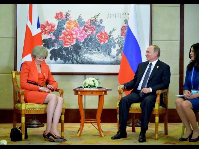 Putin holds first face-to-face meeting with new UK PM May
