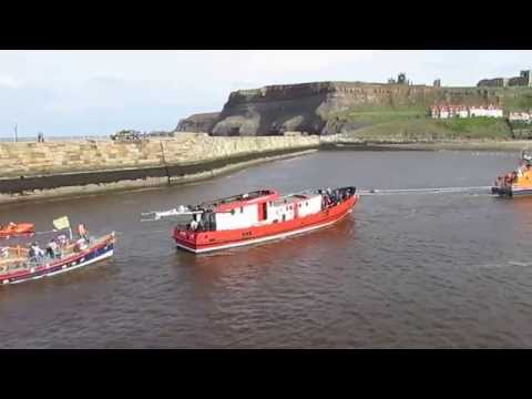 Whitby. Lifeboats rescue charter fishing boat from harbour entrance. 10.05.15.