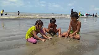 kids playing in sea beach with sand - childhood Playing