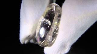 Covellite in Quartz gemstone with pink schiller effect.