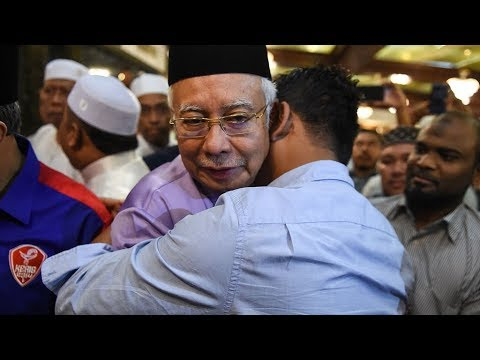 Hugs all around as Najib attends Friday prayers at Umno HQ