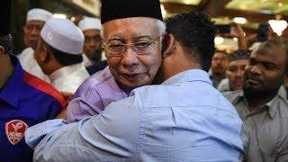 Hugs all around as Najib attends Friday prayers at Umno HQ
