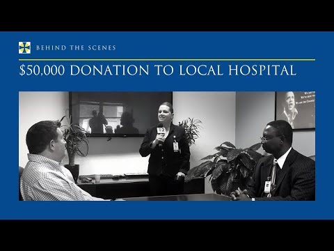 Justa Encarnacion thanks David A. Johnson for $50,000 donation to the Gov. Juan F. Luis Hospital