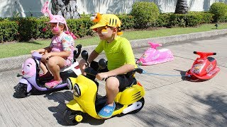Ali and Adriana Bike Ride on Power wheels and Inflatable Toys