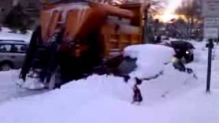 snow plow hits two cars