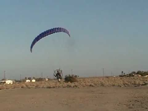 Pilot launches a speed wing with a Parajet