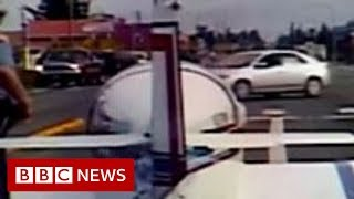 Plane lands on road and gets 'pulled over' - BBC News