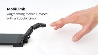 スマホ装着型の一本指ロボットがスリスリなでなでしてくれる。スマホがかわいいペット的存在に進化。