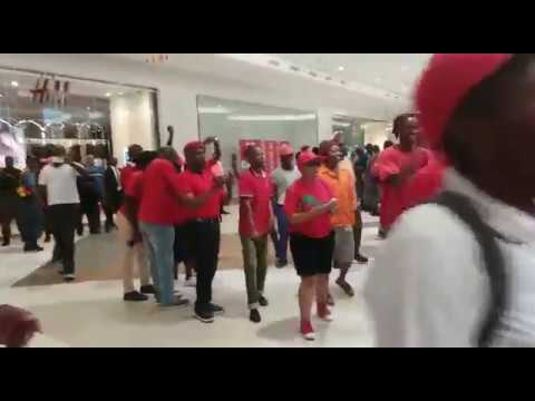 EFF members chant outside of H&M store in Sandton