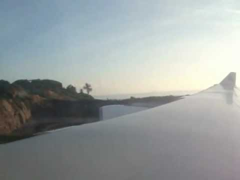 Landing in Seychelles international Airport , Emirates A340-