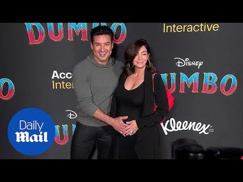 Mario Lopez Cradles Wife Courtney Baby Bump At 'Dumbo' Premiere