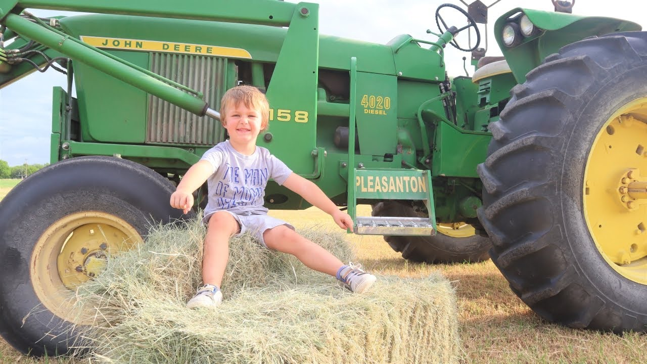 Finding toys in hay bales | Tractors for kids
