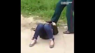 Участковый пинает ногами лежащую женщину