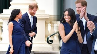 Meghan Markle shows off her baby bump as she & Harry greet thousands of fans in Melbourne
