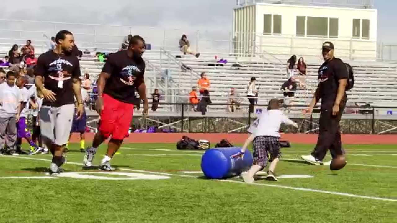 Chris Harris Jr Wesley Woodyard 2014 Youth Football And Cheerleader