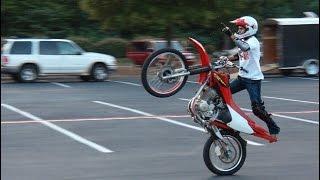 Student rides dirt bike through school!