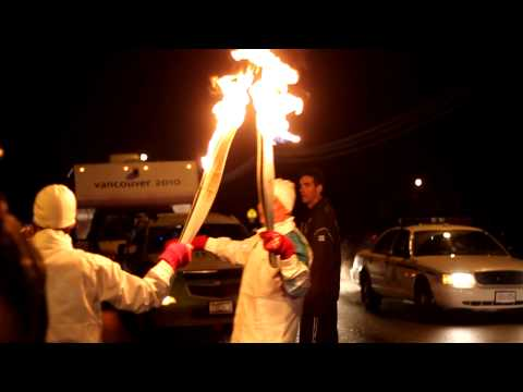 Mukhi Salim Ahmed runs with the Olympic Torch on F...