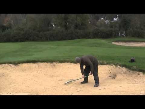 Playing and raking the 18th bunker Croham Hurst Golf Club