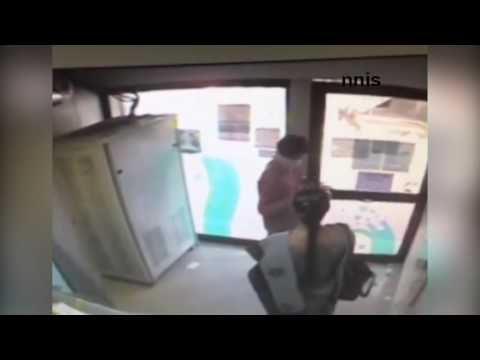 CCTV footage- Woman robbed by unidentified man at Hyderabad ATM