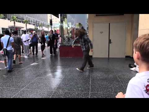 Homeless man break dancing in Times Square -  ACTUALLY good
