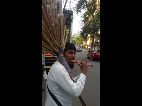 Indian Bamboo flute street flute player