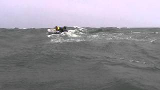 2 Inflatable boats in big swells.