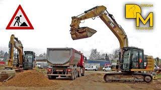 BAGGER TEAMWORK 2x CATERPILLAR 318E BELADEN MULDENKIPPER MIT SAND