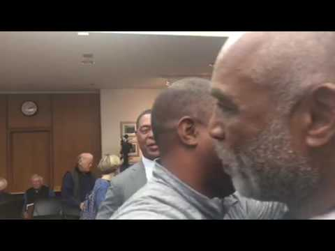 Ronnie Lott Hugs Ray Chester After Oakland Raiders ENA Passes