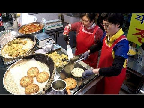 Korea Street Food. Cooking Pancakes in Mangwondong Food Market, Seoul