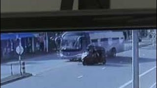 Repeat youtube video CCTV footage of luxury bus crashing into three-wheeler