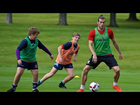 Wales stars enjoy kick around with children