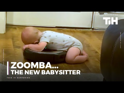 Baby Rests Torso Over Robotic Vacuum Enjoying The Spin Ride