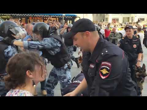Russian protesters beaten by police