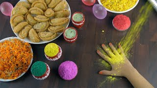 Closeup shot of woman hands playing with Holi powder colors during Holi festival