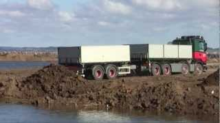 Trucks Dumping At The Harbor Dump