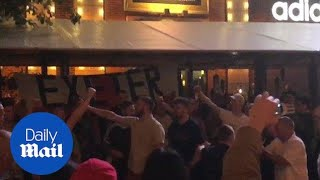 Chanting England fans gather outside team's luxury hotel