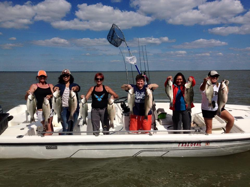 Women fishing for hybrid striped bass on lake tawakoni for Lake tawakoni fishing guides