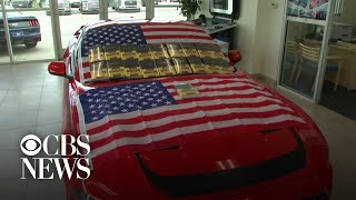 Ford dealer offers buyers a Bible, flag and a $400 gun with new car purchase